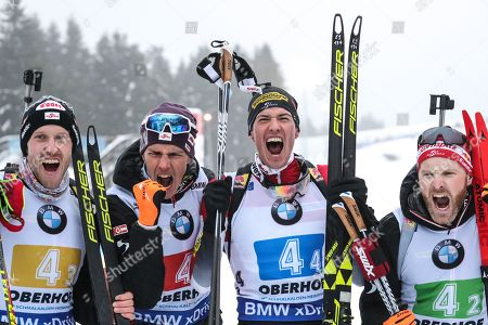 Third  placed team (R-L) Simon Eder, Julian Eberhard, Tobias Eberhard and Dominik Landertinger of Austria celebrate after the Men's 4x7.5 km relay competition at the IBU Biathlon World Cup in Oberhof, Germany, 13 January 2019.