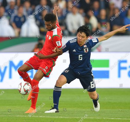Endo Wataru Japan in action against Raed Saleh of Oman during the 2019 AFC Asian Cup group F preliminary round match between Oman and Japan in Abu Dhabi, United Arab Emirates, 13 January 2019.