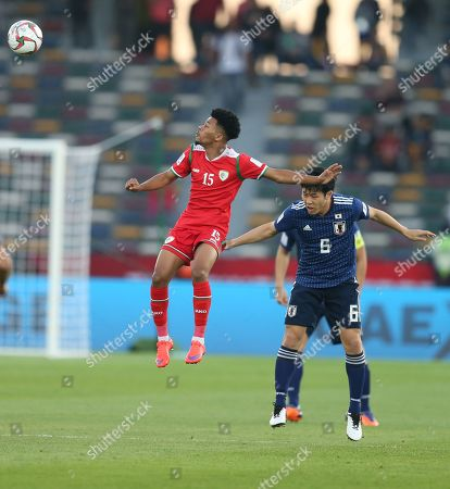 Endo Wataru (R) of Japan in action against Jameel Al Yahmadi of Oman during the 2019 AFC Asian Cup group F preliminary round match between Oman and Japan in Abu Dhabi, United Arab Emirates, 13 January 2019.