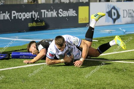 Cardiff  Blues winger Tom James (11) scores a try in the corner during the Heineken Champions Cup match between Glasgow Warriors and Cardiff Blues at Scotstoun Stadium, Glasgow