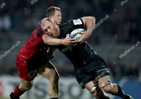 Lyon vs Saracens. Saracens' Schalk Burger tackled by Deon Fourie of Lyon
