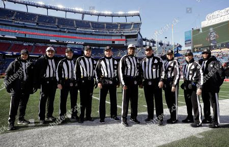 NFL game officials and alternates pose for a photo beforee an NFL divisional playoff football game between the Los Angeles Chargers and the New England Patriots, in Foxborough, Mass. From left they are, line judge Walt Coleman IV, referee Pete Morelli, field judge Brad Rogers, line judge Mark Steinkerchner, side judge Scott Edwards, referee Ron Torbert, umpire Rich Hall, down judge Sarah Thomas, back judge Dino Paganelli, and side judge Jabir Walker