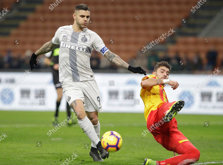 Stock Image of Inter Milan's Mauro Icardi, left, and Benevento's Luca Antei vie for the ball during an Italian Cup second round soccer match between Inter Milan and Benevento, at the San Siro stadium in Milan, Italy