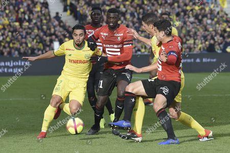 Stock Image of Nantes' Brazilian defender Fabio da Silva vies for the ball with Rennes Senegalese forward M Baye Niang