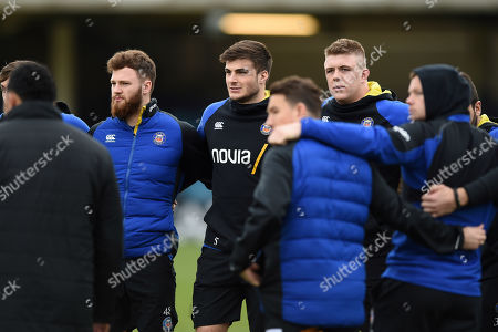 Max Wright, Josh Bayliss and Sam Nixon of Bath Rugby look on in a pre-match huddle