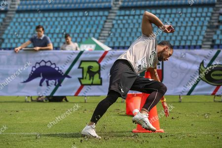 Stock Image of Cornerback Juan Marquez runs the three cone drill during a Canadian Football League (CFL) scouting draft in Mexico City, . Mexican athletes are trying out for spots in the CFL