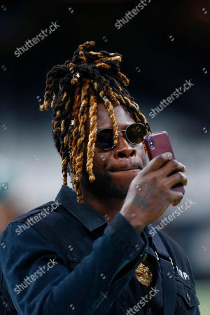 Philadelphia Eagles running back Jay Ajayi walks on the field before an NFL divisional playoff football game against the New Orleans Saints in New Orleans