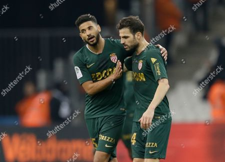 Monaco midfielder Youssef Ait-Bennasser, left, talks to Monaco midfielder Cesc Fabregas during the League One soccer match between Marseille and Monaco at the Velodrome stadium, in Marseille, southern France