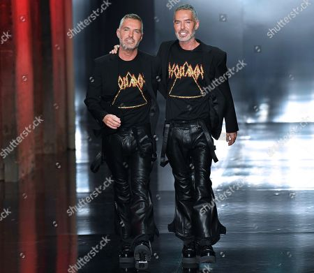 Canadian designers and twin brothers Dan Caten and Dean Caten appear on the catwalk after the presentation of their Dsquared2  Fall/Winter 2019/20 collection during the Milan Men's Fashion Week, in Milan, Italy, 13 January 2019. Fall/Winter 2019/20 collections are presented at the Milano Moda Uomo from 11 to 14 January.