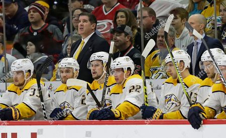 Nashville Predators coach Peter Laviolette watches from the bench during the first period of an NHL hockey game against the Carolina Hurricanes in Raleigh, N.C