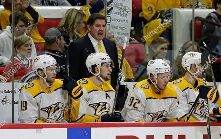 Nashville Predators coach Peter Laviolette yells from the bench during the first period of an NHL hockey game against the Carolina Hurricanes in Raleigh, N.C