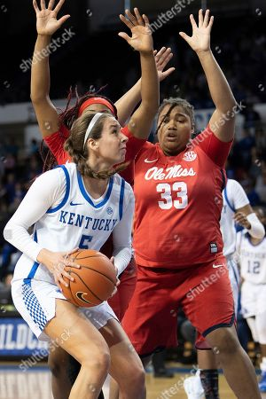 Kentucky guard Blair Green (5) shoots the ball around Mississippi forward La'Karis Salter (33) and guard Crystal Allen (5) during an NCAA basketball game, in Lexington, Ky