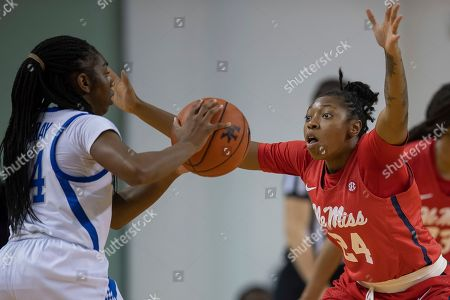 Stock Picture of Mississippi guard Shannon Dozier (24) blocks the shot of Kentucky guard Taylor Murray (24) during an NCAA basketball game, in Lexington, Ky