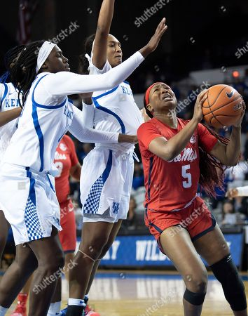 Mississippi guard Crystal Allen (5) shoots the ball around several Kentucky defenders during an NCAA basketball game, in Lexington, Ky