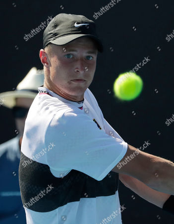 Rudolf Molleker of Germany in action during his men's singles match against Diego Schwartzman of Argentina on day one of the Australian Open Grand Slam tennis tournament in Melbourne, Australia, 14 January 2019.