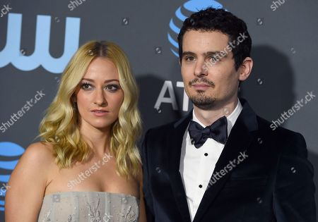 Olivia Hamilton, Damien Chazelle. Olivia Hamilton, left, and Damien Chazelle arrive at the 24th annual Critics' Choice Awards, at the Barker Hangar in Santa Monica, Calif
