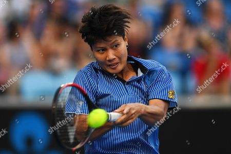 Luksika Kumkhum of Thailand in action against Ashleigh Barty of Australia during their women's singles first round match of the Australian Open tennis tournament in Melbourne, Australia, 14 January 2019.