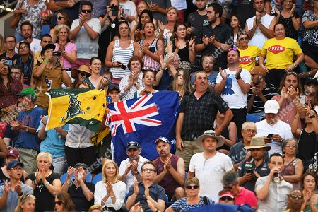 Australian fans cheer during the women's singles first round match between Ashleigh Barty of Australia and Luksika Kumkhum of Thailand at the Australian Open tennis tournament in Melbourne, Australia, 14 January 2019.