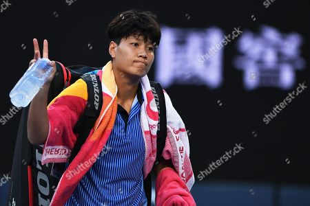 Luksika Kumkhum of Thailand leaves the court after losing her women's singles first round match against Ashleigh Barty of Australia at the Australian Open tennis tournament in Melbourne, Australia, 14 January 2019.