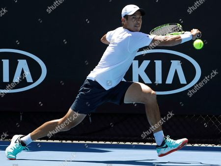 Australia's Jason Kubler makes a backhand return to Italy's Thomas Fabbiano during their first round match at the Australian Open tennis championships in Melbourne, Australia