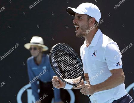 Stock Picture of Italy's Thomas Fabbiano reacts after winning a point against Australia's Jason Kubler against during their first round match at the Australian Open tennis championships in Melbourne, Australia
