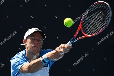 Argentina's Diego Schwartzman makes a backhand return to Germany's Rudolf Molleker during their first round match at the Australian Open tennis championships in Melbourne, Australia