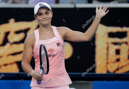 Australia's Ashleigh Barty celebrates after defeating Thailand's Luksika Kumkhum in their first round match at the Australian Open tennis championships in Melbourne, Australia