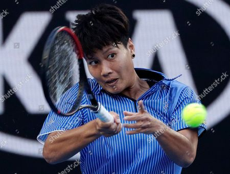 Thailand's Luksika Kumkhum makes a forehand return to Australia's Ashleigh Barty during their first round match at the Australian Open tennis championships in Melbourne, Australia
