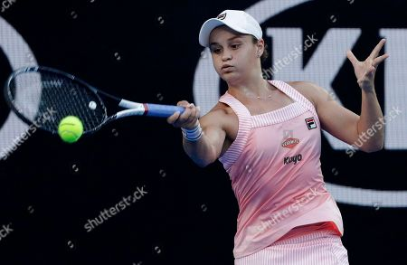 Australia's Ashleigh Barty makes a forehand return to Thailand's Luksika Kumkhum during their first round match at the Australian Open tennis championships in Melbourne, Australia