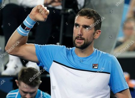 Croatia's Marin Cilic celebrates after defeating Australia's Bernard Tomic during their first round match at the Australian Open tennis championships in Melbourne, Australia