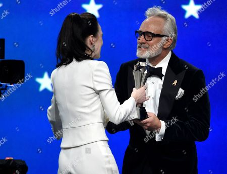"Stock Photo of Rachel Brosnahan, Bradley Whitford. Bradley Whitford, right, presents the award for best actress in a comedy series to Rachel Brosnahan for ""The Marvelous Mrs. Maisel"" at the 24th annual Critics' Choice Awards, at the Barker Hangar in Santa Monica, Calif"