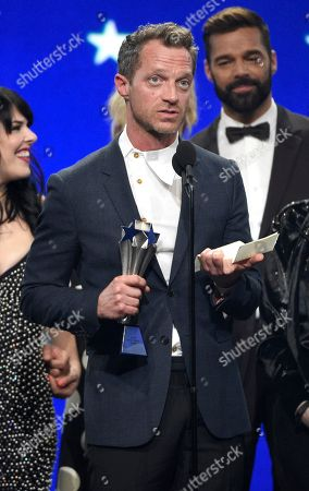 "Tom Rob Smith accepts the award for best limited series for ""The Assassination of Gianni Versace: American Crime Story"" at the 24th annual Critics' Choice Awards, at the Barker Hangar in Santa Monica, Calif"