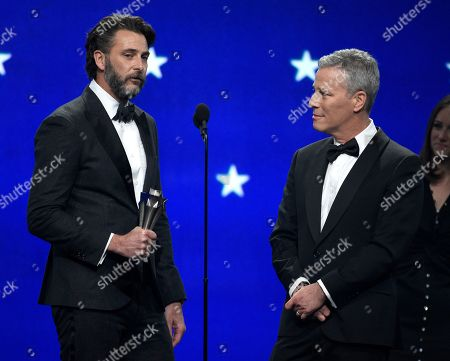 """Stock Picture of Andrew Form, Brad Fuller. Andrew Form, left, and Brad Fuller accept the award for best sci-fi or horror movie for """"A Quiet Place"""" at the 24th annual Critics' Choice Awards, at the Barker Hangar in Santa Monica, Calif"""