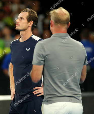 Andy Murray of Great Britain stands with Mark Petchey