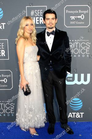Olivia Hamilton (L) and husband Damien Chazelle (R) arriving for the 24th Annual Critics' Choice Awards at Barker Hangar in Santa Monica, California, USA, 13 January 2019. The Critics' Choice Awards honors the finest in cinematic and television achievement.