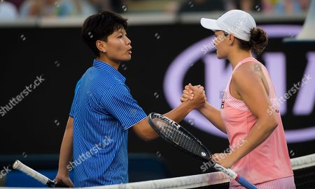 Luksika Kumkhum of Thailand and Ashleigh Barty of Australia at the net after their first-round match