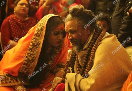 A Religious leader Namdeo Das Tyagi (R) known as Comptuer baba meets Head of Kinnar Akhara or transgender congregation Laxmi Narayan Tripathi (L) at Kumbh Mela festival in Allahabad, Uttar Pradesh, India, 14 January 2019. According to the news report, The Transgender sadhus (Holy people) are participating in the Kumbh festival for the first time. The Hindu festival is one of the biggest in India and the world with holy men called sadhu performing rituals. Kumbh Mela is being held from 15 January 2019 to 04 March 2019 in Allahabad in Uttar Pradesh.
