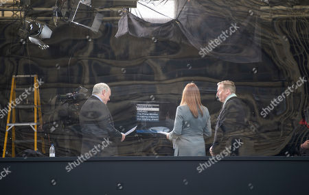 Stock Picture of Sky news presenters, including Adam Boulton (Left) present from behind a perspex screen on College Green in Westminster after verbal abuse was thrown at presenters by Brexit Campaigners last week.