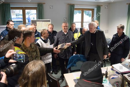 German Minister of Interior, Construction and Homeland Horst Seehofer (2-R) and Bavarian Minister of the Interior, Joachim Herrmann (C), during a visit of the mission control center of the rescue operations in Berchtesgaden, Bavaria, Germany, 14 January 2019. Austria and southern Germany have received heavy snowfalls in the past days. Weather forecasts warn that a snowstorm could cause roadblocks and increased avalanche danger in many parts of the affected region.
