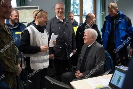 Bavarian Minister of the Interior, Joachim Herrmann (4-L), German Minister of Interior, Construction and Homeland Horst Seehofer (C) and the Mayor of Berchtesgaden Franz Rasp (R), during a visit of the mission control center of the rescue operations in Berchtesgaden, Bavaria, Germany, 14 January 2019. Austria and southern Germany have received heavy snowfalls in the past days. Weather forecasts warn that a snowstorm could cause roadblocks and increased avalanche danger in many parts of the affected region.