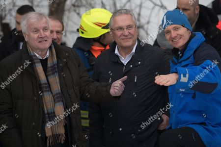 German Minister of Interior, Construction and Homeland Horst Seehofer (L), Bavarian Minister of the Interior, Joachim Herrmann (C) and the Mayor of Berchtesgaden Franz Rasp (R) during a visit of the snow removal work at the ice stadium in Berchtesgaden, Bavaria, Germany, 14 January 2019. Austria and southern Germany have received heavy snowfalls in the past days. Weather forecasts warn that a snowstorm could cause roadblocks and increased avalanche danger in many parts of the affected region.
