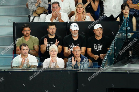 Janko Tipsarevic (back L) of Serbia and Marian Vajda (back R) of Slovakia, coach of Serbia's Novak Djokovic, sit in the player's box of Djokovic during his men's singles first round match against Mitchell Krueger of the USA at the Australian Open Grand Slam tennis tournament in Melbourne, Australia, 15 January 2019.