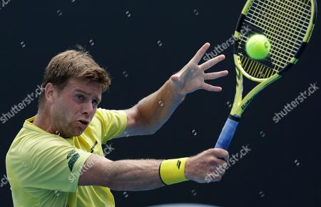 United States' Ryan Harrison makes a backhand return to Jiri Vesely of the Czech Republic during their first round match at the Australian Open tennis championships in Melbourne, Australia