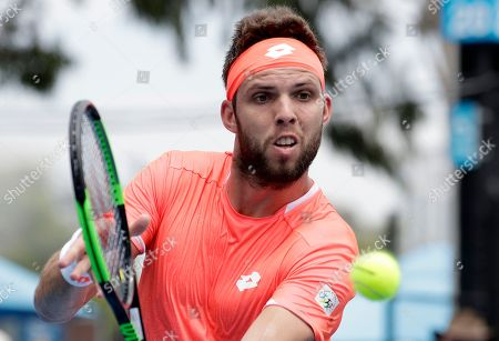 Jiri Vesely of the Czech Republic makes a backhand return to United States' Ryan Harrison during their first round match at the Australian Open tennis championships in Melbourne, Australia