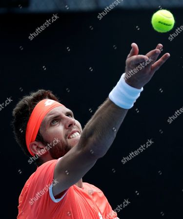 Jiri Vesely of the Czech Republic serves to United States' Ryan Harrison during their first round match at the Australian Open tennis championships in Melbourne, Australia