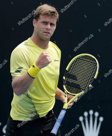 United States' Ryan Harrison reacts after winning a point against Jiri Vesely of the Czech Republic during their first round match at the Australian Open tennis championships in Melbourne, Australia