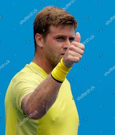 United States' Ryan Harrison celebrates after defeating Jiri Vesely of the Czech Republic in their first round match at the Australian Open tennis championships in Melbourne, Australia