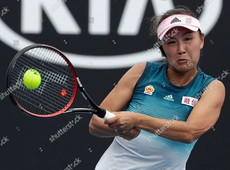 China's Peng Shuai makes a backhand return to Canada Eugenie Bouchard during their first round match at the Australian Open tennis championships in Melbourne, Australia