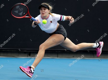 Canada's Eugenie Bouchard makes a forehand return to China's Peng Shuai during their first round match at the Australian Open tennis championships in Melbourne, Australia