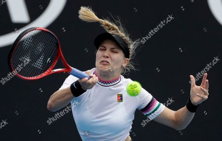 Canada's Eugenie Bouchard hits a forehand return to China's Peng Shuai during their first round match at the Australian Open tennis championships in Melbourne, Australia